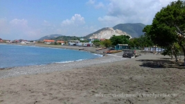 Carib Beach against the backdrop of omnipresent mountains