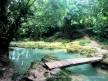 Wooden bridge over a calmer portion of the river