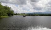black river safari- boat sailing past
