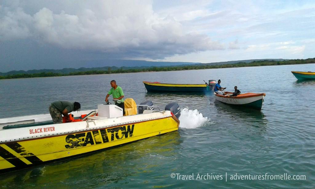 boats surrounding pelican bar