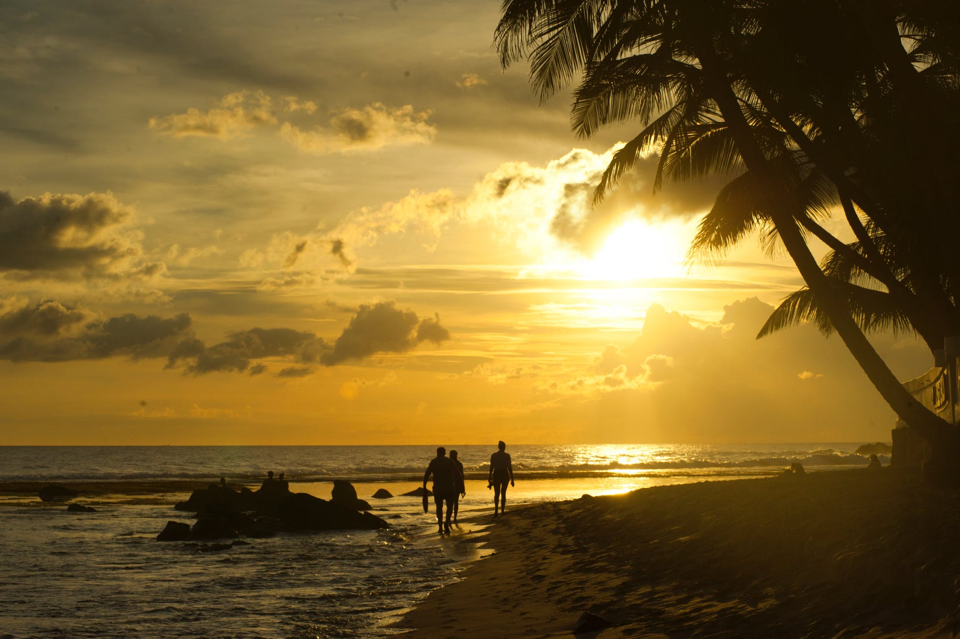 backlit beach caribbean clouds
